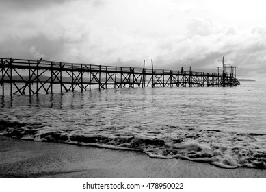 Silent morning  Picturing a bamboo jetty on the Beach, in Pangandaran - Indonesia. The picture taken in the morning. Black and White photography