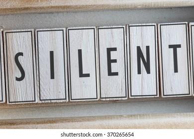 SILENT word written on wooden