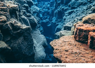 Silfra hall between two tectonic plates in national park Thingvellir Iceland, blue crystal clear pure water and colorful rocks stones volcanic lava formations underwater popular snorkeling diving site