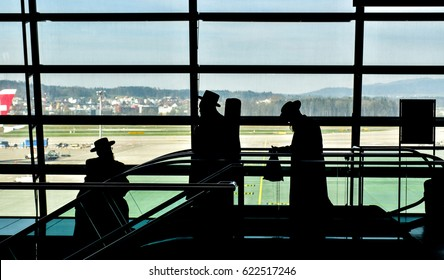 Silhouette 3 rabbi walking in the airport