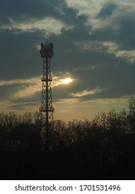 silhouette of 5G antenna tower in sunset time
