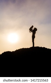 Silhouette about mother's love for her baby