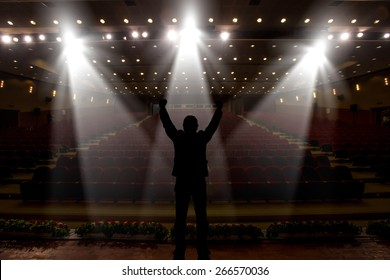 Silhouette of actors in the spotlight