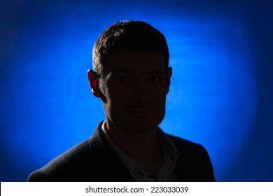 Silhouette of an adult male in his early forties wearing a jacket and shirt.