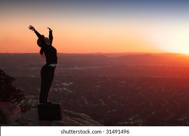 Silhouette of African American Business Woman on top of Hill during Sunset