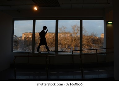 The silhouette against the window