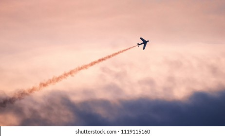 Silhouette air fighter flying against sky during sunset