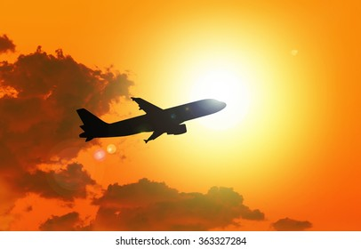 Silhouette of an  airplane taking off , sunset evening sky