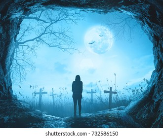 Silhouette alone woman standing on tomb stone at blue night halloween background. 3D illustration.