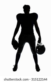 Silhouette American football player holding ball and helmet against white background