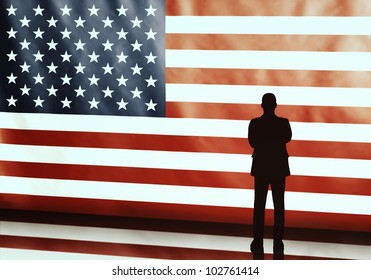 Silhouette of an american politician with arms crosses on flag background