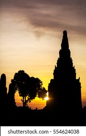Silhouette of ancient ruined wat Chaiwatthanaram at sunset in Ayutthaya, Thailand