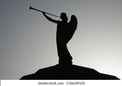 Silhouette of an angel on top of a dome