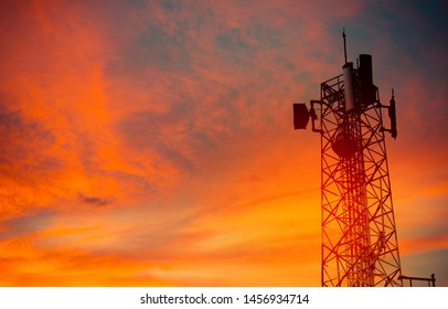 silhouette of antenna and orange sunset sky background.