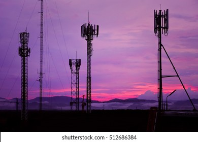 Silhouette Antenna tower and repeater of Communication and telecommunication with the mountain on the background of sunset.