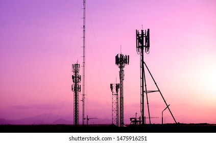 Silhouette Antenna tower and repeater of telecommunication. violet tone