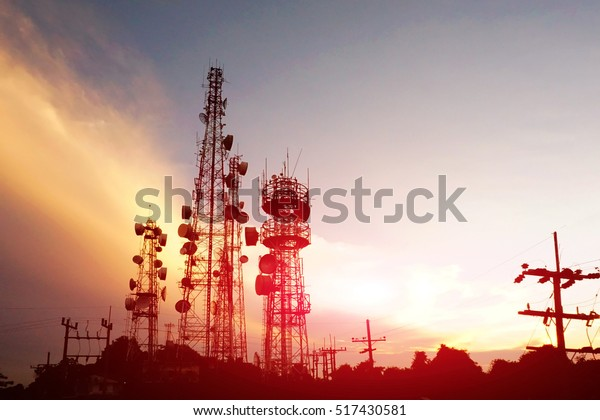 silhouette antennas on sunset time and sky on sunset time background.