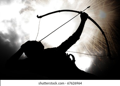 A silhouette of an archer, on the backdrop of a sky with exploding gun powder.