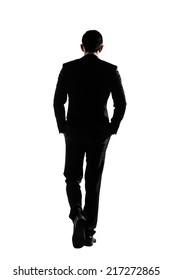 Silhouette of Asian business man walk with confidence, full length portrait isolated on white. Rear view.