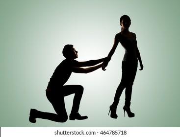 man on knees begging
