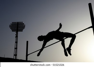 Silhouette of athlete competing in pole vault