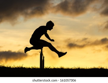 silhouette of an athlete in hurdling in track and field