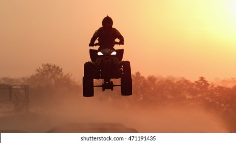 Silhouette ATV or Quad bikes Jump in the sunset.