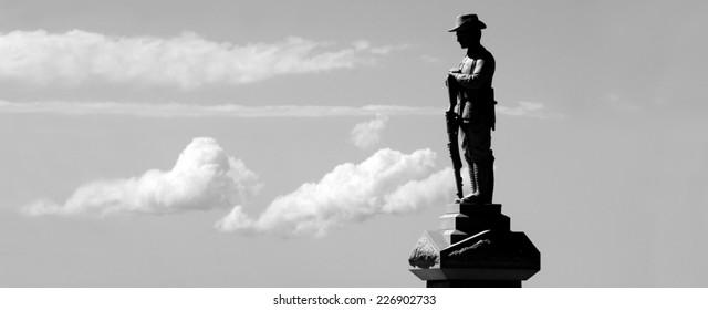 Silhouette of Australian soldier sculpture from WW2 in ANZAC Square in Broadwater Parklands Gold Coast Queensland Australia.