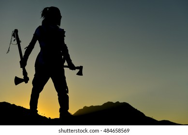 silhouette of an ax man