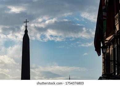 silhouette in backlight of Piazza del Popolo square with obelisk in Rome. Italy