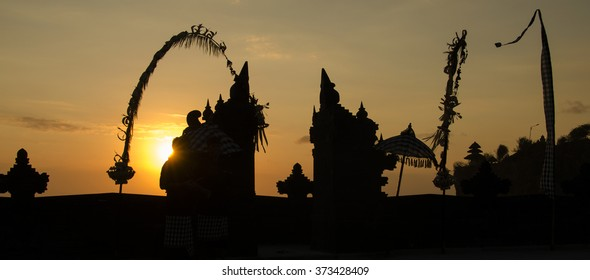 Silhouette of Balinese traditional gate with sunset background