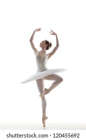 silhouette of ballerina in classical tutu in the white studio