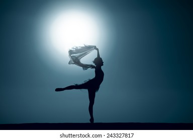 Silhouette of a ballet dancer dancing at sunset