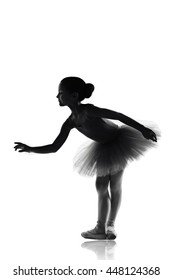 silhouette of ballet dancer girl in pointe and tutu isolated on white, little curious balerina. education lessons in Classic dance school black and white