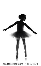 silhouette of ballet dancer girl in pointe and tutu isolated on white, little balerina with working foot pointing to front in second position. Education lessons in Classic dance school black and white