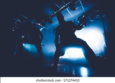 silhouette of a band on stage