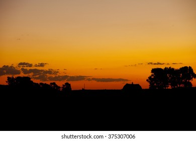 Silhouette of barn and trees on farm in South Dakota