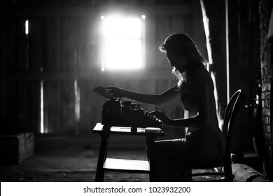 Silhouette of a beautiful girl in a dress on the background of a window in an old house