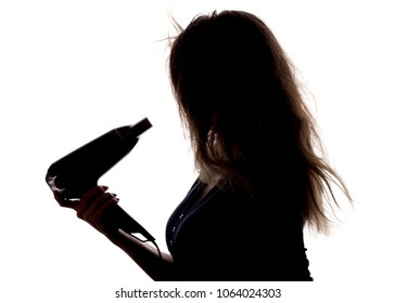 silhouette of a beautiful girl with hairdryer in hand on white isolated background, concept of fashion, beauty and body care