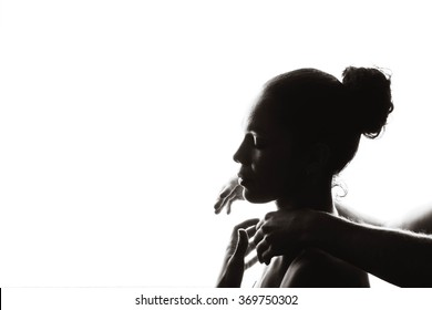 Silhouette of a beautiful girl and man's hands on a white background