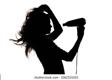 silhouette of a beautiful girl profile doing a hairstyle with hair dryer on white isolated background, concept of fashion, beauty and body care