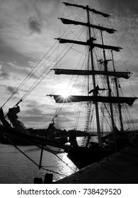Silhouette of beautiful old ship in the sunset