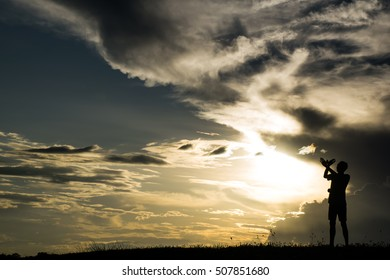 Silhouette of a beautiful sunset background blur