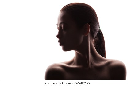 silhouette of beautiful young woman. isolated on white studio background