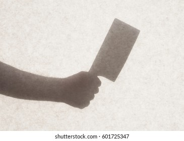 Silhouette behind a transparent paper - Cleaver knife