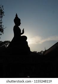 Silhouette Bhudda on blue sky