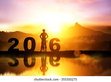 Silhouette bicycle in 2016 text on sunset,Friendship in bicycle sport.happy new year