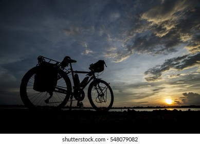 silhouette of a bicycle before sunset background.