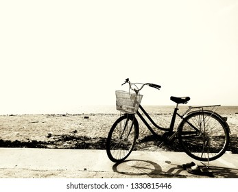 Silhouette of bicycle on beach background