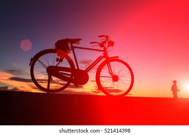 silhouette of bicycle of sunrise on the Songkhla beach in the morning